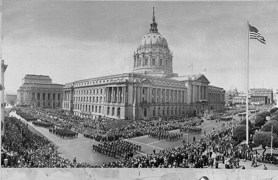 This is the earliest San Francisco Armistice Day photo found in The Chronicle archive. It shows a parade around San Francisco City Hall in 1945. Photo: Photographer Unknown, The Chronicle