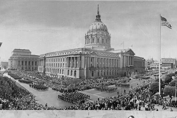 Armistice Day parade around San Francisco City Hall, 1945  Envelope stamped 11/30/1945