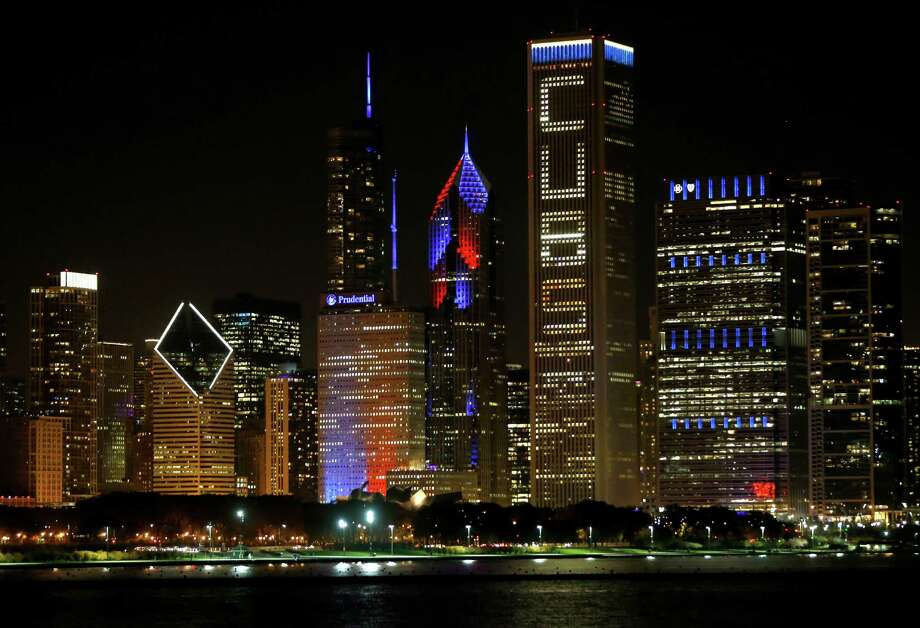 The Chicago skyline is lit with supportive window messages for Chicago Cubs fans after an earlier rally in Grant Park honoring the World Series baseball champions, Friday, Nov. 4, 2016. (AP Photo/Charles Rex Arbogast) ORG XMIT: ILCA128 Photo: Charles Rex Arbogast / Copyright 2016 The Associated Press. All rights reserved.