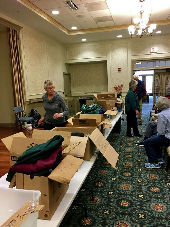Shaker Pointe held a coat drive Friday morning. The winter-wear items collected will be donated to the U.S. Committee on Refugees and Immigrants, which will then distribute the items to refugees in the regional area. (Alison Krawczyk)