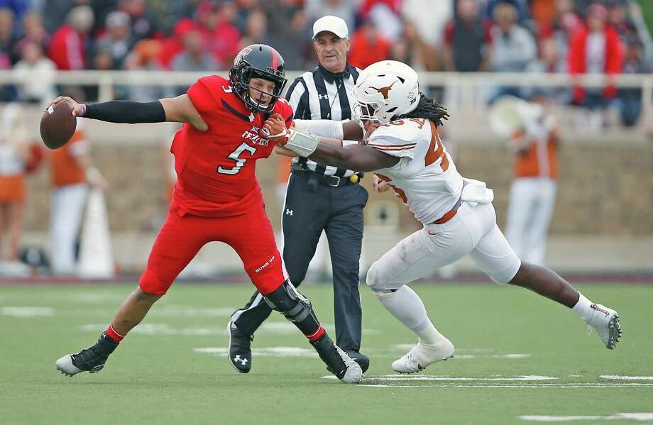 A revived Malik Jefferson had eight tackles against Texas Tech, including 11/2 sacks of Patrick Mahomes, left. Photo: Brad Tollefson, MBI / Lubbock Avalanche-Journal