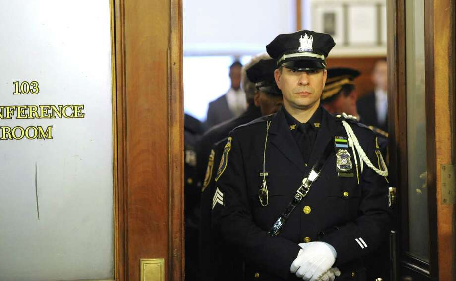 Honor Guard Sgt. Ken Sesock leads the 31 new recruits for the Albany Police Department from a meeting with Mayor Jennings to get their police badges in a ceremony at City Hall in Albany, N.Y. Jan. 12, 2012.    ( Skip Dickstein/Times Union) Photo: Skip Dickstein / 2011