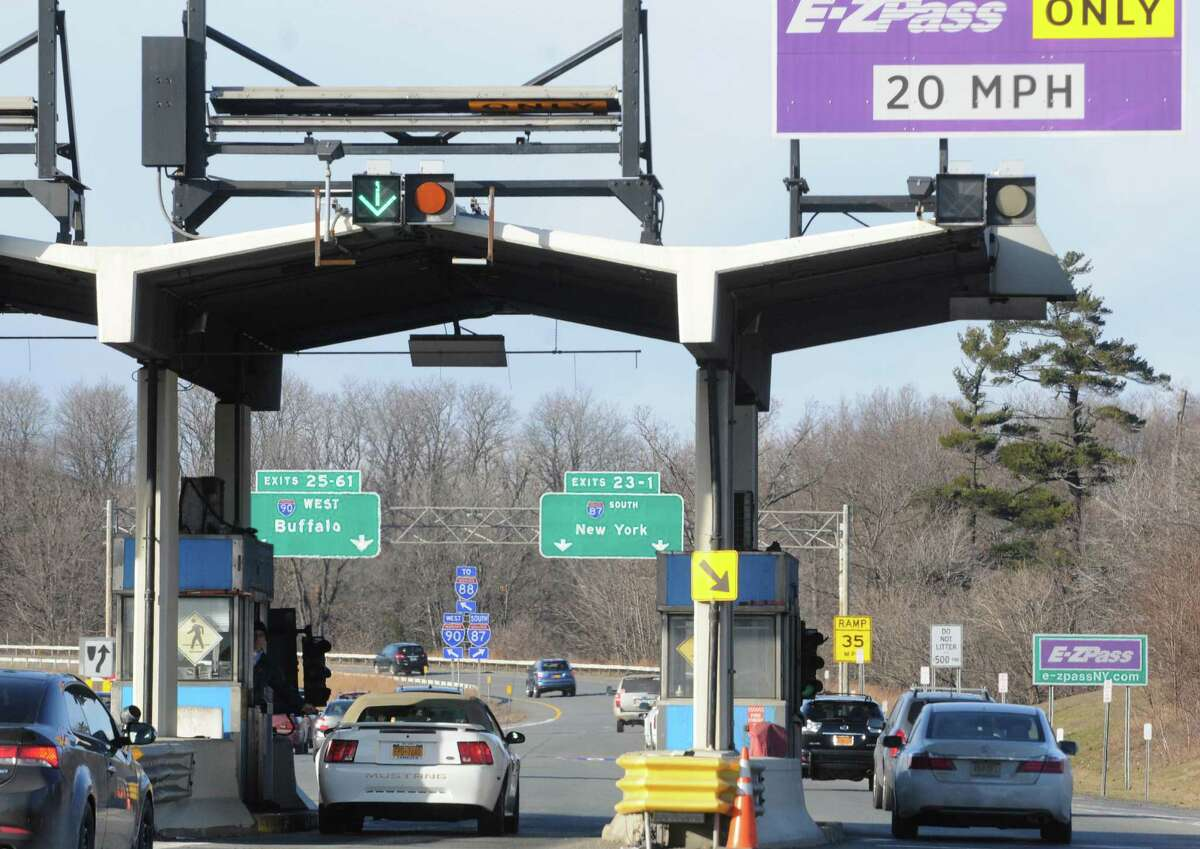 A New York State Thruway Authority toll collector works the booth next to an E-ZPass lane at Exit 24 on Wednesday Dec. 31, 2014, in Albany, N.Y. (Michael P. Farrell/Times Union)
