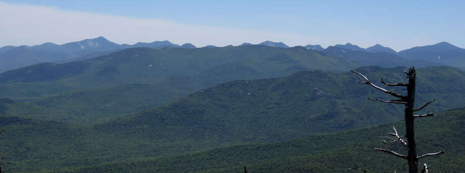 The eastern Adirondack High Peaks from somewhere on Sentinel Mountain. Mount Marcy is furthest to the right. (Herb Terns / Times Union) Photo: Picasa