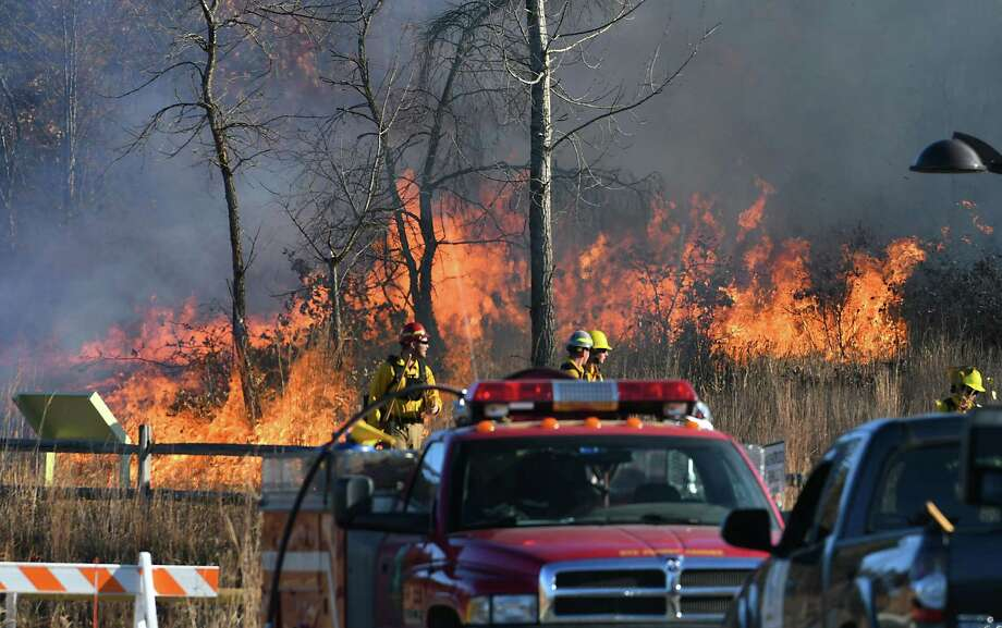 The Albany Pine Bush Preserve Commission conducts a prescribed fire near the Discovery Center on Monday, Nov. 7, 2016 in Albany, N.Y. (Lori Van Buren / Times Union) Photo: Lori Van Buren / 20038715A