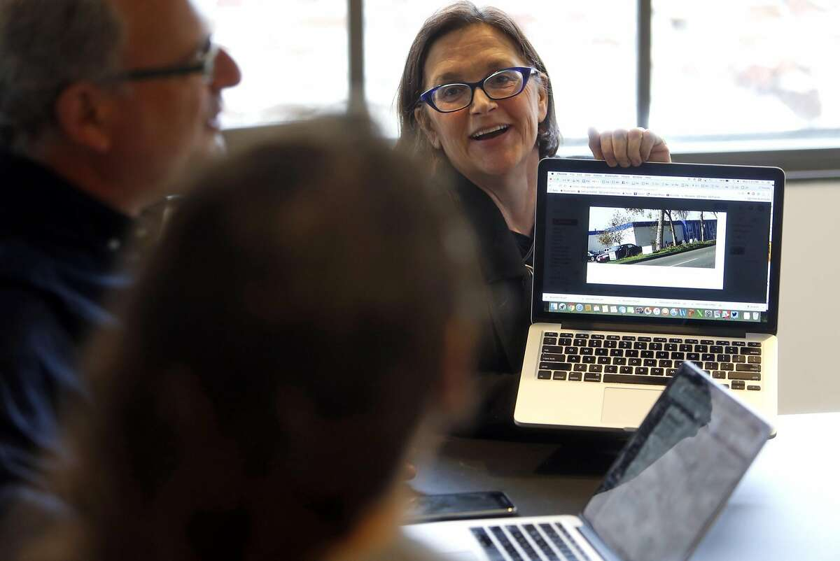 Co-founder Frances Dinkelspiel shows a photo to fellow co-founder Lance Knobel and senior reporter Emilie Raguso during a budget meeting at Berkeleyside independent news organization headquarters in Berkeley, Calif., on Monday, November 7, 2016.