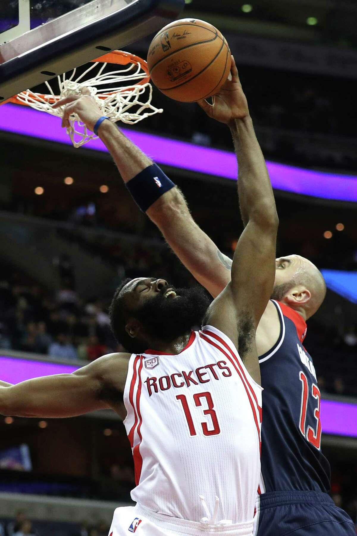 WASHINGTON, DC - NOVEMBER 07: James Harden #13 of the Houston Rockets has a shot blocked by Marcin Gortat #13 of the Washington Wizards during the first half at Verizon Center on November 7, 2016 in Washington, DC. NOTE TO USER: User expressly acknowledges and agrees that, by downloading and or using this photograph, User is consenting to the terms and conditions of the Getty Images License Agreement.