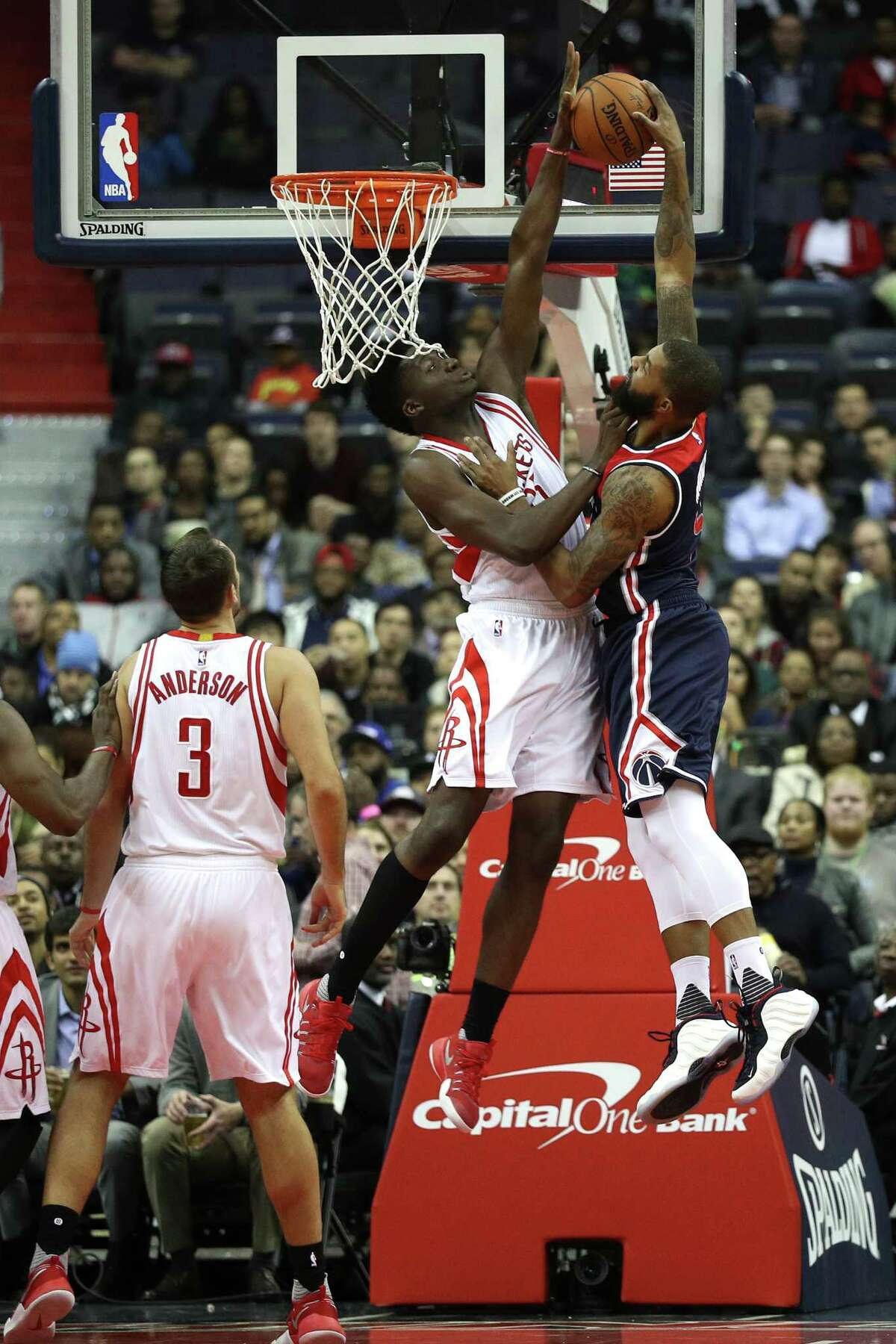WASHINGTON, DC - NOVEMBER 07: Markieff Morris #5 of the Washington Wizards has a shot blocked by Clint Capela #15 of the Houston Rockets during the first half at Verizon Center on November 7, 2016 in Washington, DC. NOTE TO USER: User expressly acknowledges and agrees that, by downloading and or using this photograph, User is consenting to the terms and conditions of the Getty Images License Agreement.