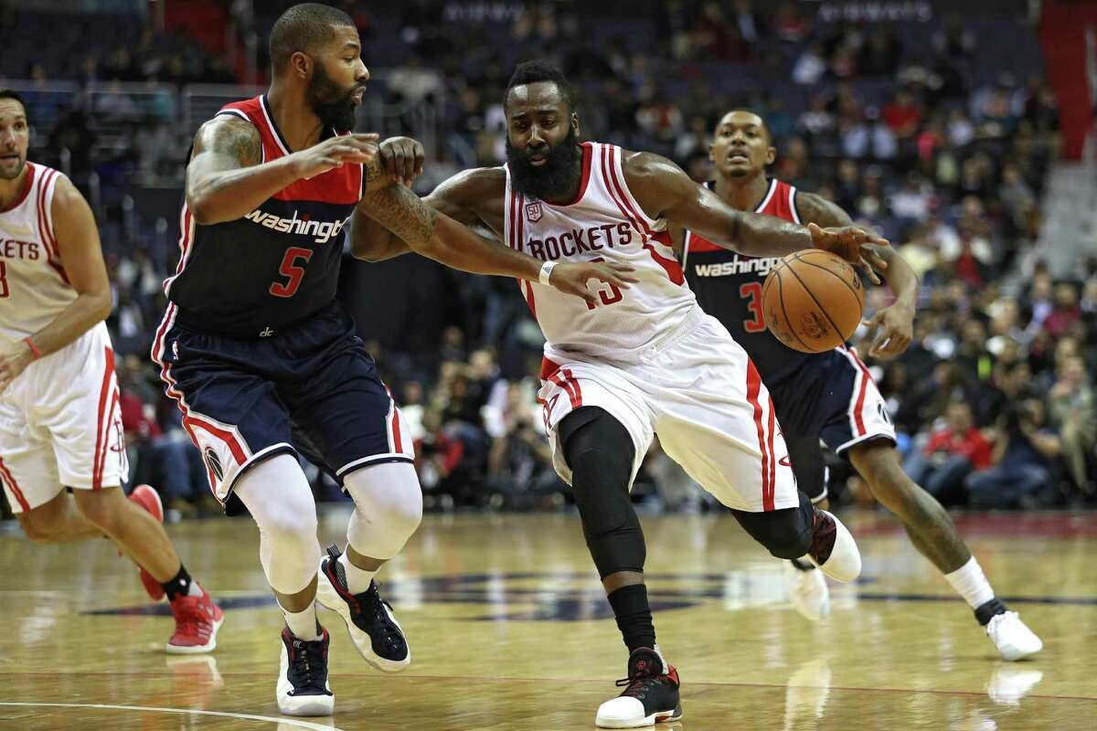 WASHINGTON, DC - NOVEMBER 07: James Harden #13 of the Houston Rockets dribbles in front of Markieff Morris #5 of the Washington Wizards during the first half at Verizon Center on November 7, 2016 in Washington, DC. NOTE TO USER: User expressly acknowledges and agrees that, by downloading and or using this photograph, User is consenting to the terms and conditions of the Getty Images License Agreement.