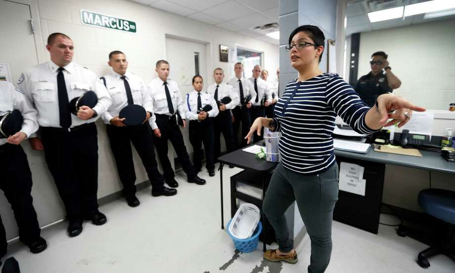 Intake manager Erika Garza talks to cadets with the Houston Police Department on Monday about the intake process as they tour the Houston Recovery Center's Sobering Center. Photo: Karen Warren, Staff Photographer / 2016 Houston Chronicle