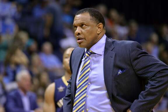 New Orleans Pelicans head coach Alvin Gentry stands on the court during a timeout in the first half of the team's NBA basketball game against the Memphis Grizzlies on Wednesday, Nov. 2, 2016, in Memphis, Tenn. (AP Photo/Brandon Dill)