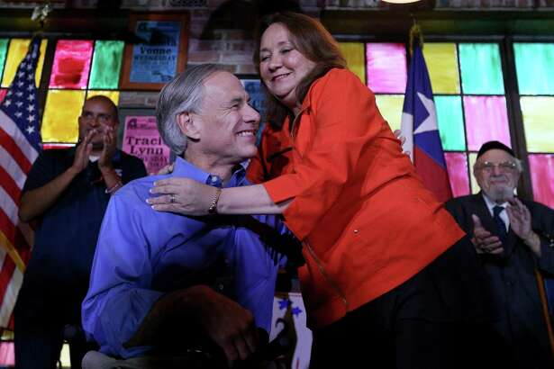 Texas Gov. Greg Abbott hugs his wife Cecilia Abbott  during a campaign event for Republican candidates U.S. Rep. Will Hurd and state Reps. John Lujan and Rick Galindo held Monday Nov. 7, 2016 at The County Line.