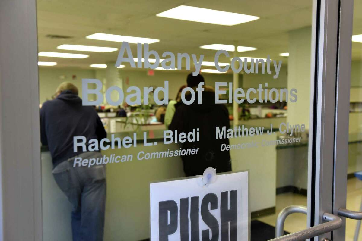 Voters ask for polling information at the Albany County Board of Elections on Monday, Nov. 7, 2016, Albany, N.Y. (Will Waldron/Times Union)