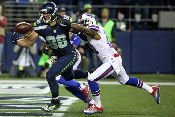 Seattle Seahawks tight end Jimmy Graham grabs catches a touchdown with one hand while being guarded by Buffalo Bills defensive back Nickell Robey-Coleman during the first half of an NFL football game at CenturyLink Field on Nov. 7, 2016.