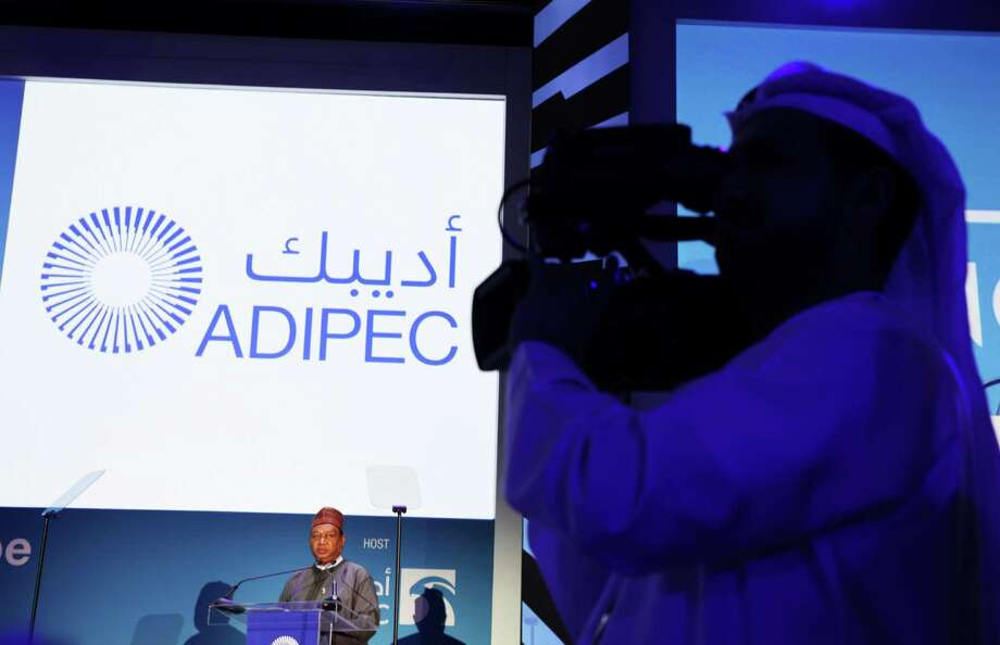 An Emirati journalist films the audience as OPEC Secretary-General Mohammad Sanusi Barkindo of Nigeria gives a speech at the annual Abu Dhabi International Petroleum Exhibition & Conference in Abu Dhabi, United Arab Emirates, on Monday, Nov. 7, 2016. Those attending the onference this week remain worried about low global oil prices. (AP Photo/Jon Gambrell) Photo: Jon Gambrell, STF / Copyright 2016 The Associated Press. All rights reserved.