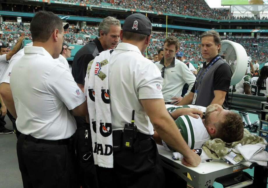 New York Jets quarterback Ryan Fitzpatrick (14) is checked on the sidelines, during the second half of an NFL football game against the Miami Dolphins, Sunday, Nov. 6, 2016, in Miami Gardens, Fla. (AP Photo/Lynne Sladky) ORG XMIT: HRS114 Photo: Lynne Sladky / Copyright 2016 The Associated Press. All rights reserved.