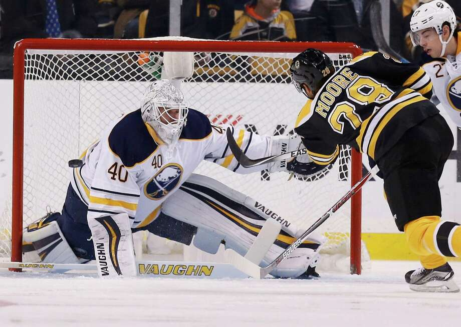 Boston Bruins' Dominic Moore (28) takes a shot on Buffalo Sabres' Robin Lehner (40), of Sweden, during the first period of an NHL hockey game in Boston, Monday, Nov. 7, 2016. (AP Photo/Michael Dwyer) ORG XMIT: MAMD102 Photo: Michael Dwyer / Copyright 2016 The Associated Press. All rights reserved.