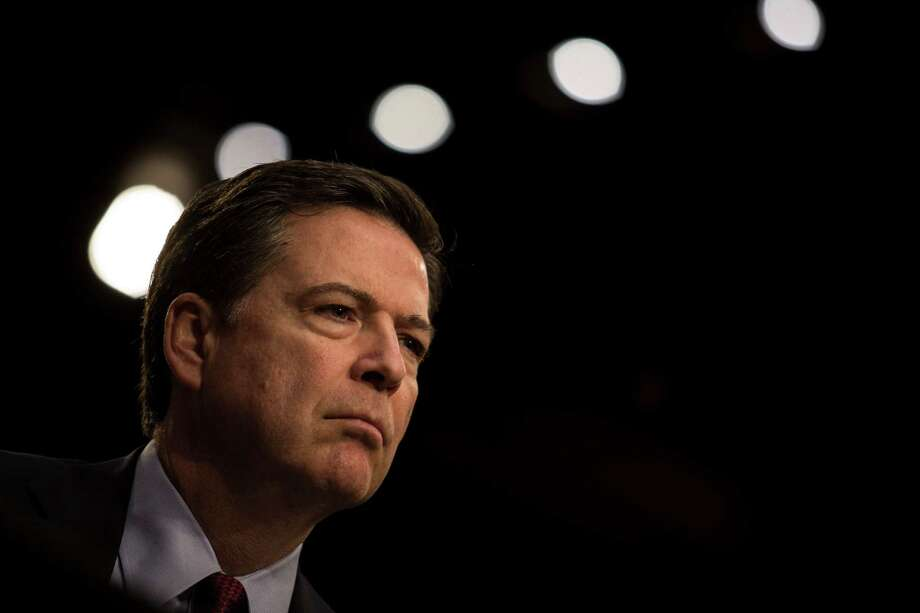 FILE — James Comey, the director of the FBI, testifies at a Senate hearing on Capitol Hill in Washington, Feb. 9, 2016. Friends and colleagues say that Comey feels that he is under no pressure to leave office, but regardless of who wins the presidential election, there will be complications. (Drew Angerer/The New York Times) ORG XMIT: XNYT39 Photo: DREW ANGERER / NYTNS