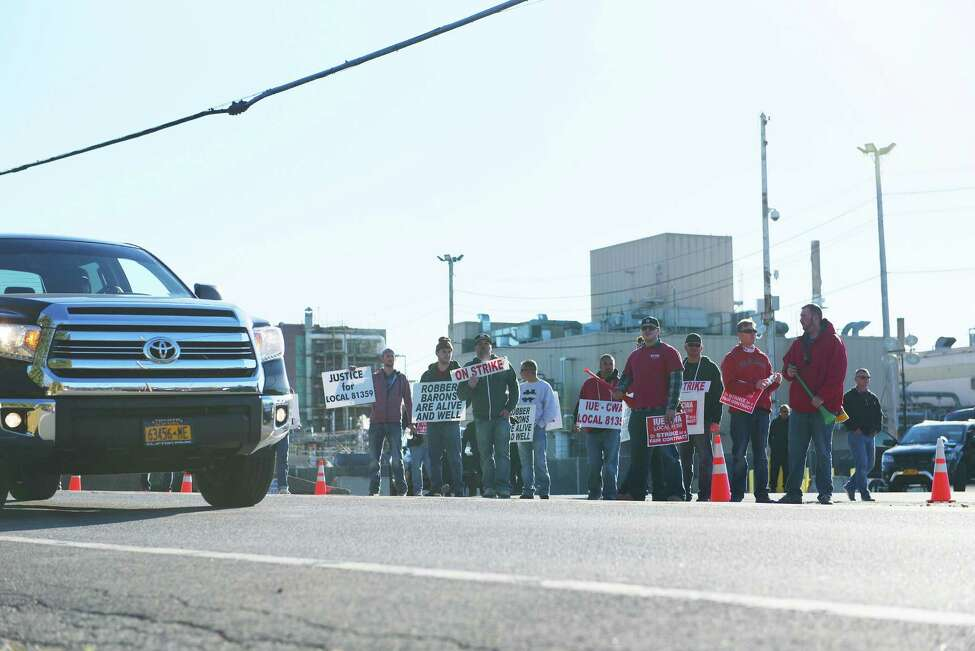 Momentive employees who are members of the UE-CWA Local 81359 union take part in a picket as they strike outside the Momentive plant on Monday, Nov. 7, 2016, in Waterford, N.Y. (Paul Buckowski / Times Union)