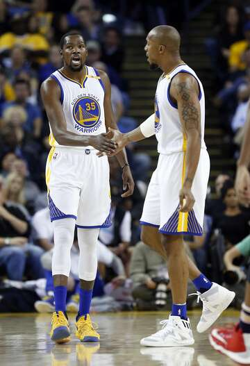 578c2c1867e 1of11Golden State Warriors  Kevin Durant and David West slap hands after  New Orleans Pelicans called a 2nd quarter time out during NBA game at  Oracle Arena ...