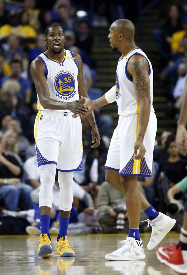 Golden State Warriors' Kevin Durant and David West slap hands after New Orleans Pelicans called a 2nd quarter time out during NBA game at Oracle Arena in Oakland, Calif., on Monday, November 7, 2016. Photo: Scott Strazzante, The Chronicle