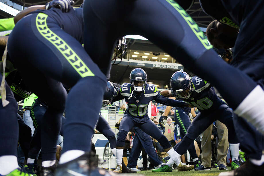 The Legion of Boom huddles before warming up before a game against the Buffalo Bills at CenturyLink Field on Nov. 7, 2016. Photo: GRANT HINDSLEY, SEATTLEPI.COM / SEATTLEPI.COM