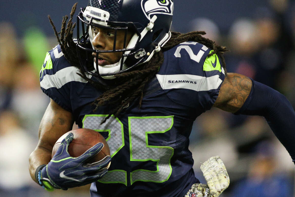 Seattle Seahawks cornerback Richard Sherman runs the ball after grabbing an interception in the endzone during the second half of an NFL football game against the Buffalo Bills at CenturyLink Field on Nov. 7, 2016.