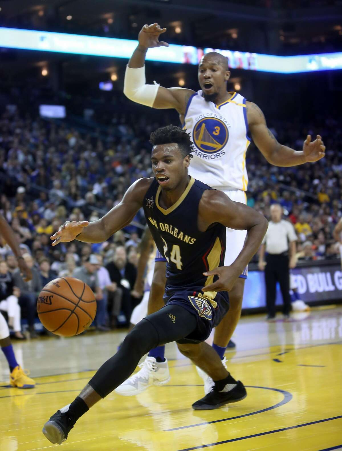 Golden State Warriors' David West watches New Orleans Pelicans' Bobby Hield chase a loose ball in 4th quarter of Warriors' 116-106 win during NBA game at Oracle Arena in Oakland, Calif., on Monday, November 7, 2016.