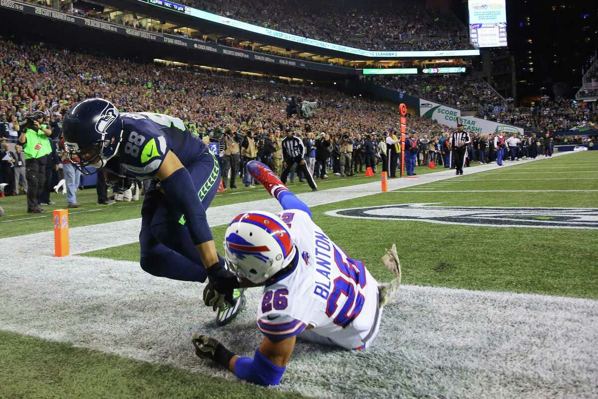 Seahawks tight end Jimmy Graham scores a touchdown as Bills safety Robert Blanton defends, during the second quarter of the start of Seattle's game against Buffalo, Monday, Nov. 7, 2016 at CenturyLink Field.