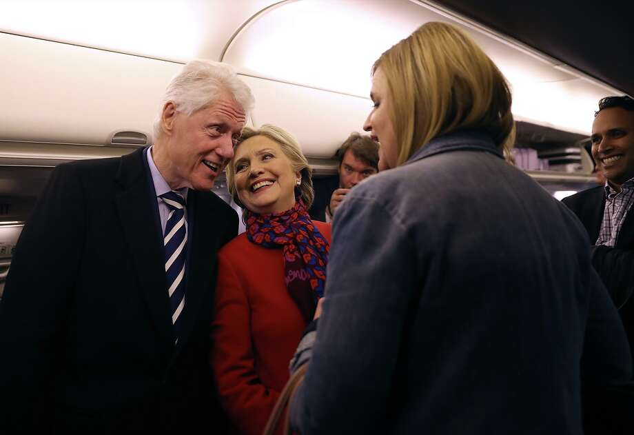 Democratic presidential nominee former Secretary of State Hillary Clinton (R) and her husband former U.S. President Bill Clinton talk aboard her campaign plane at Philadelphia International Airport on November 7, 2016 in Philadelphia Pennsylvania. With one day to go until election day, Hillary Clinton is campaigning in Pennsylvania, Michigan and North Carolina.  (Photo by Justin Sullivan/Getty Images) Photo: Justin Sullivan/Getty Images