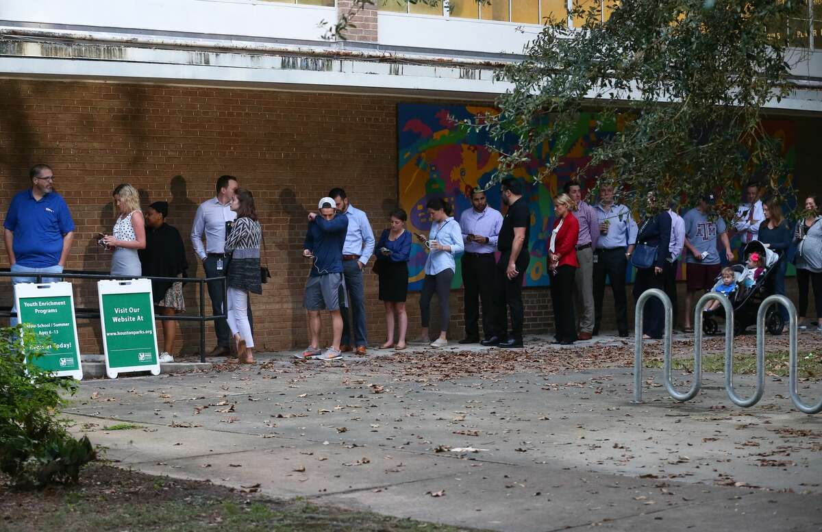 People wait in line to vote as the polls open at the Love Park Community Center, Tuesday, Nov. 8, 2016, in Houston, Texas. (Jon Shapley/Houston Chronicle)