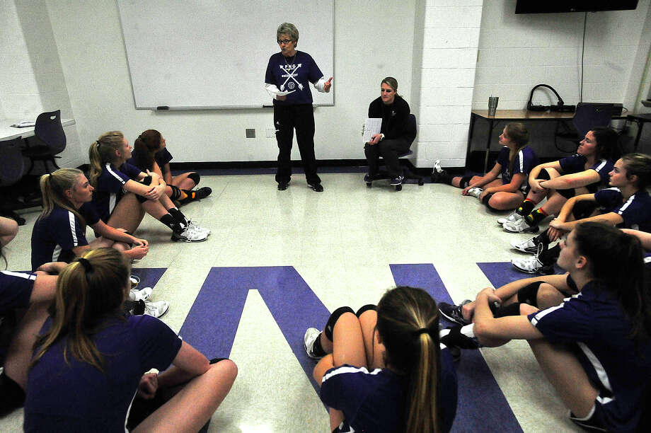 Port Neches-Groves head coach Barbara Comeaux and assistant Brittany Fuge discuss recent game performances with the team before getting into practice drills Monday before facing Barbers Hill in Tuesday's regional playoff. Photo taken Monday, November 7, 2016 Kim Brent/The Enterprise Photo: Kim Brent / Beaumont Enterprise