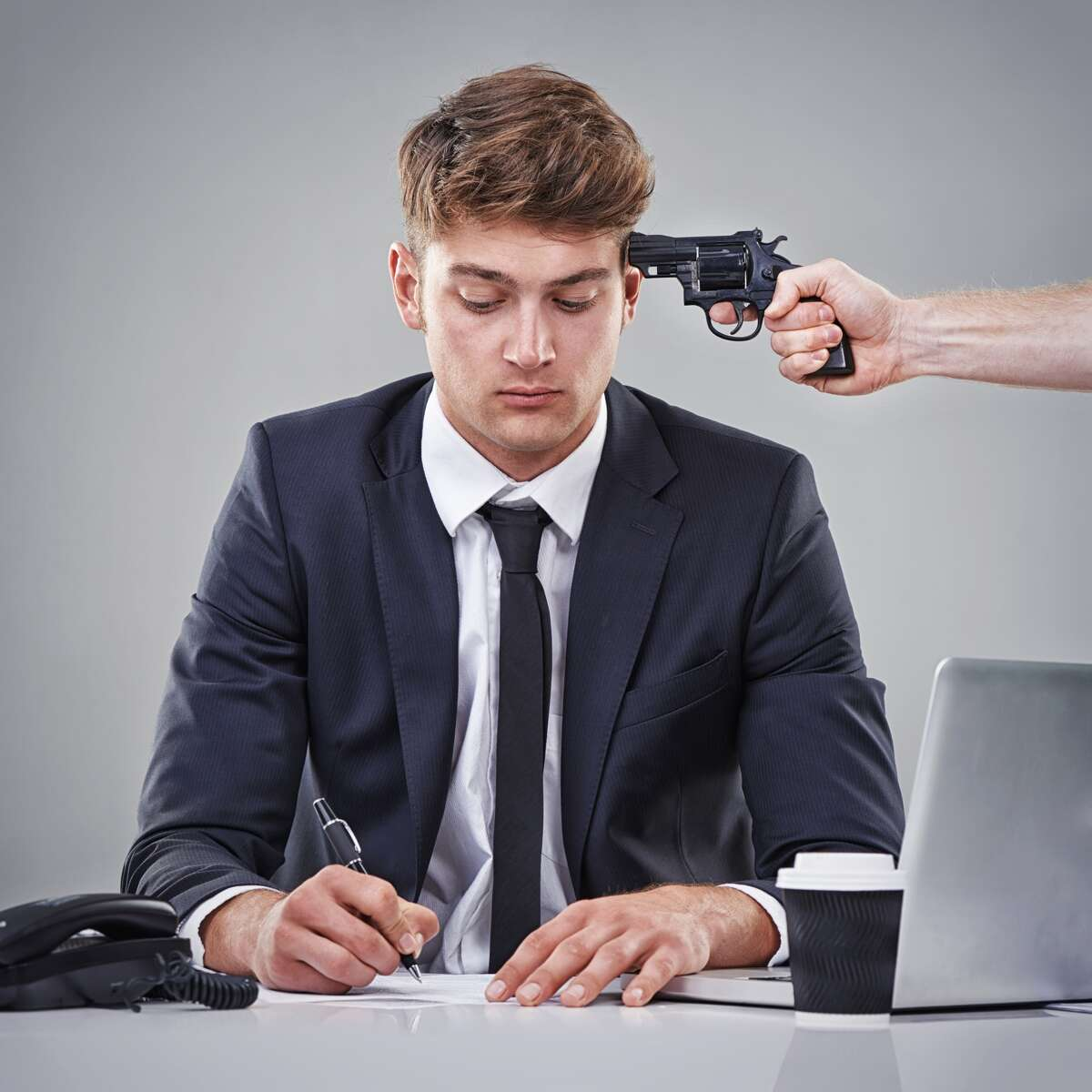 A business man signing a piece of paper with someone pointing a gun at his headhttp://195.154.178.81/DATA/i_collage/pi/shoots/783303.jpg
