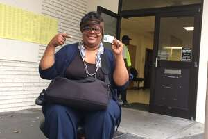 Voter Tanuqe Smith was turned away from a polling site, so she had to find a new polling place on Tuesday.