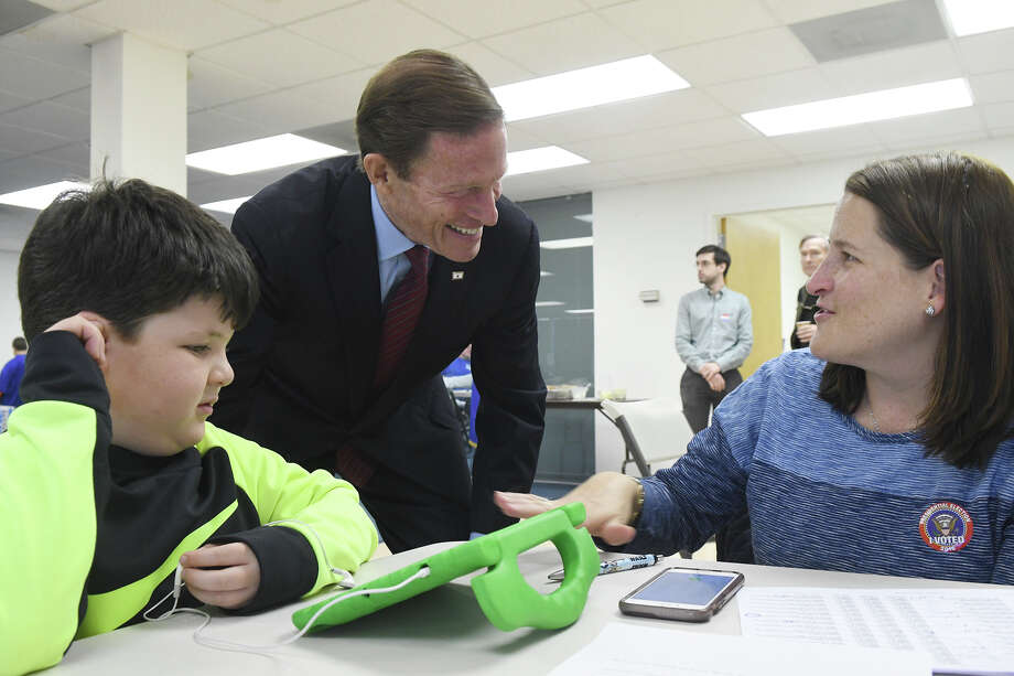 Sen. Richard Blumenthal, D-Conn., chats with volunteer Meredith Curreri and her son Teddy as he stops off at the Stamford Democratic Committee Headquarters to thank the volunteers working to get the vote out in Stamford, Conn., Nov. 8, 2016. Blumenthal is running for reelection to the office which he has held since 2011. Photo: Keelin Daly, For Hearst Connecticut Media / Stamford Advocate freelance