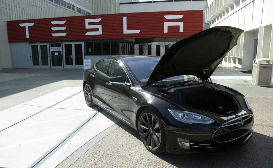 Tesla Motors says it has agreed to buy Grohmann Engineering to help automate its electric car manufacturing. The acquisition of the German factory-equipment maker, which will be renamed Tesla Grohmann Automation, will enable the Fremont, California, plant to accelerate its production rate further, the U.S. company said. Photo: Associated Press /File Photo / AP