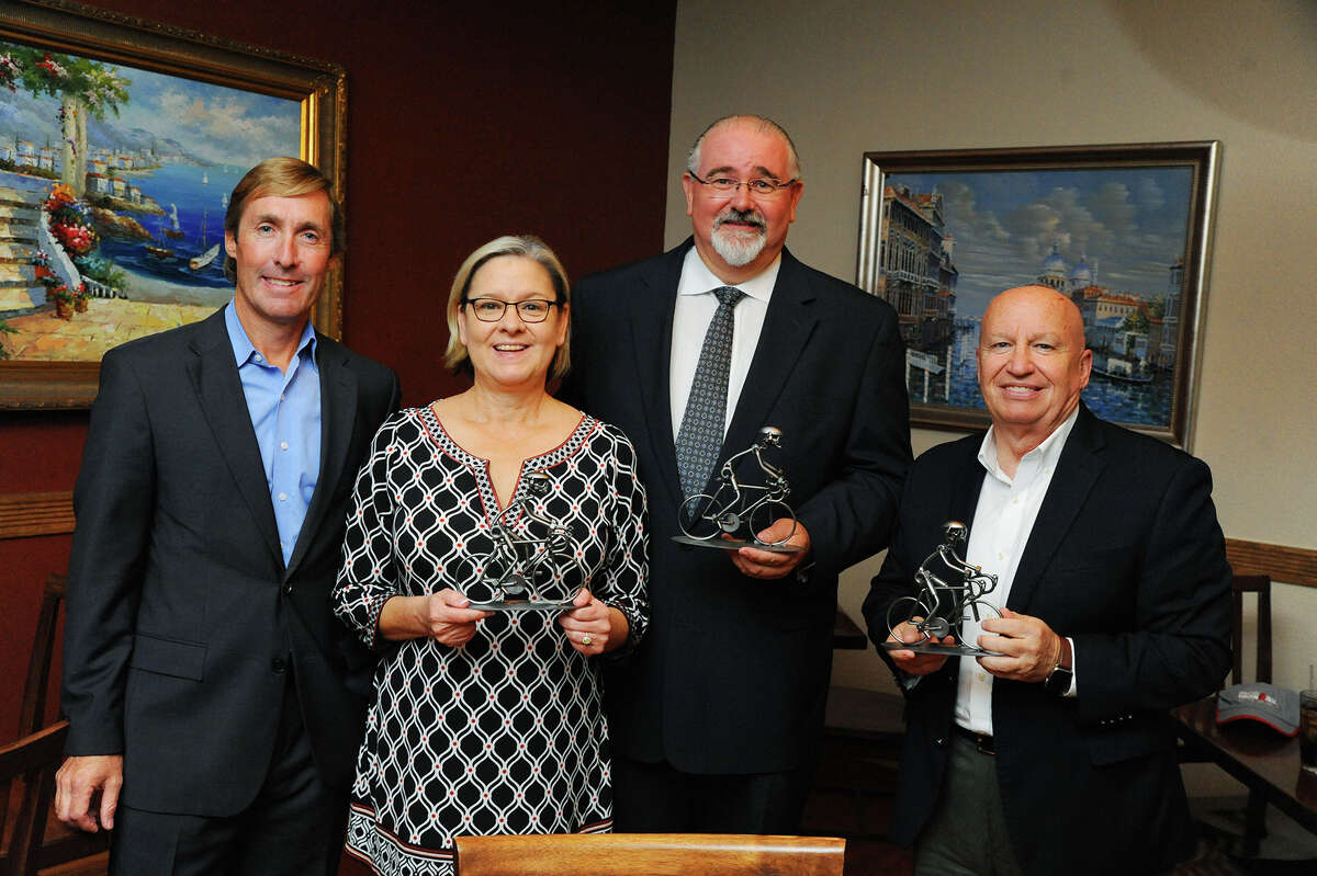 Memorial Hermann The Woodlands CEO Josh Urban gives awards to Tomball Mayor Gretchen Fagan, Precinct 4 Commissioner Jack Cagle and Congressman Kevin Brady, R-The Woodlands, who all worked to shift the 2016 Ironman Texas cycling route through Tomball.