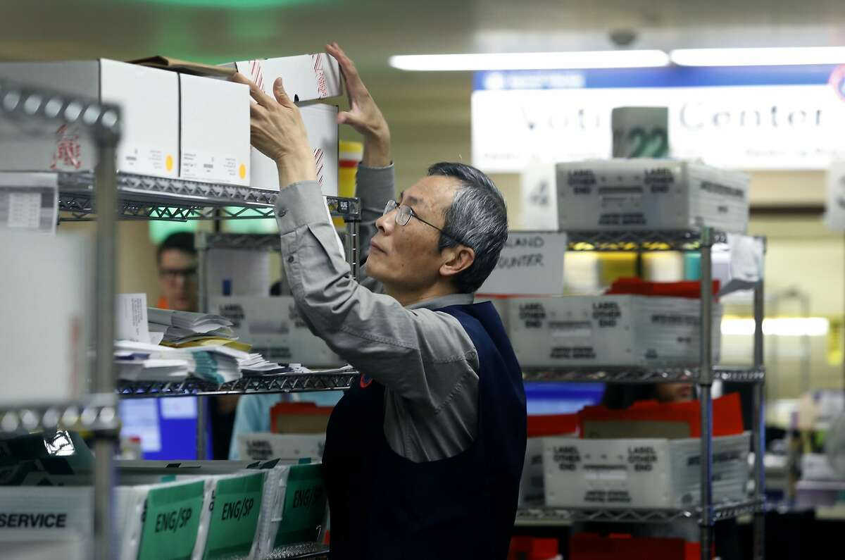 Department of Elections worker Steven Ku organizes boxes of blank ballots on Election Day at City Hall in San Francisco, Calif. on Tuesday, Nov. 8, 2016.