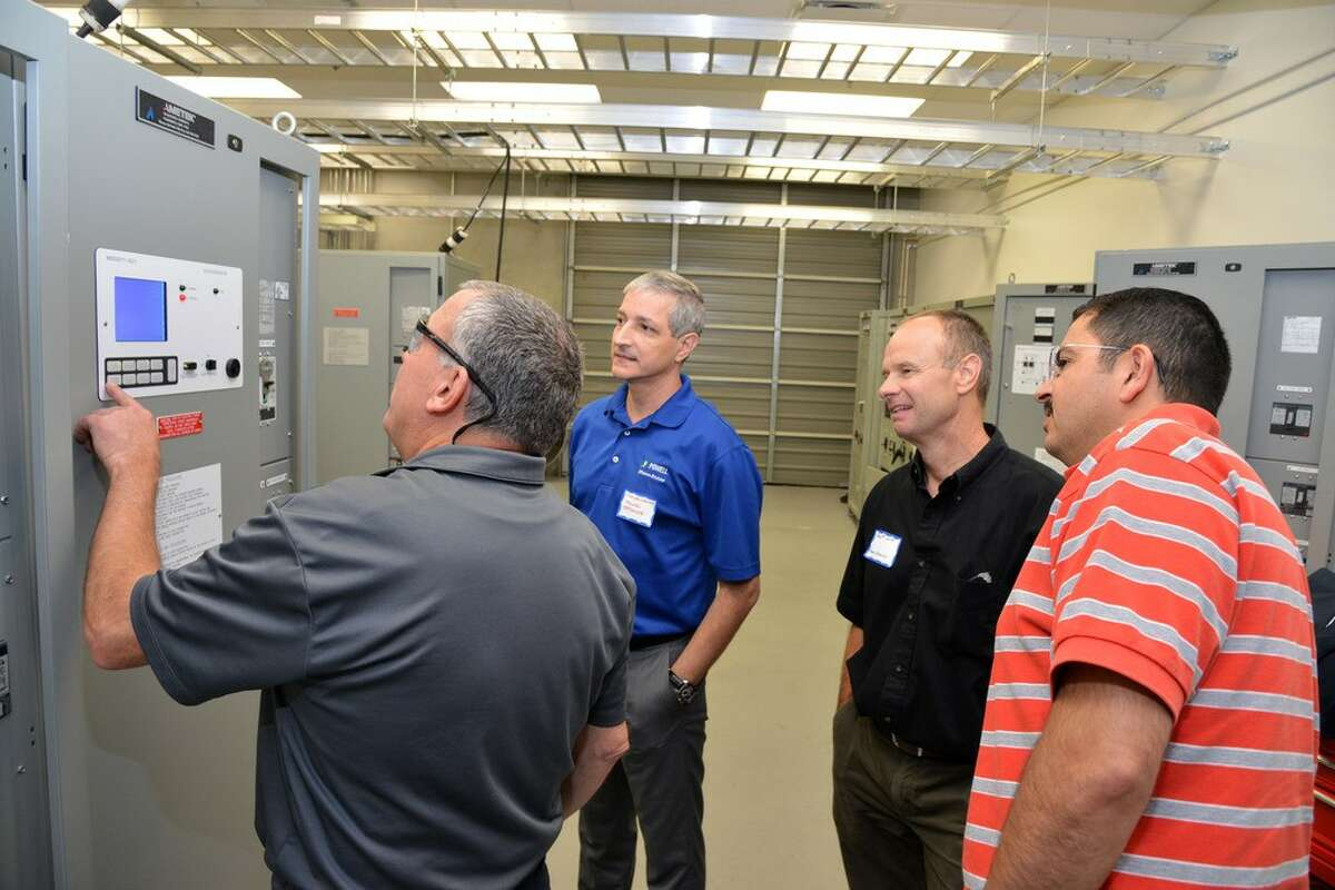 Don Imlay, manager of training and support for Ametek Solidstate Controls, demonstrates features of the company's Digital ProcessPower uninterrupted power supply to participants of a training course.
