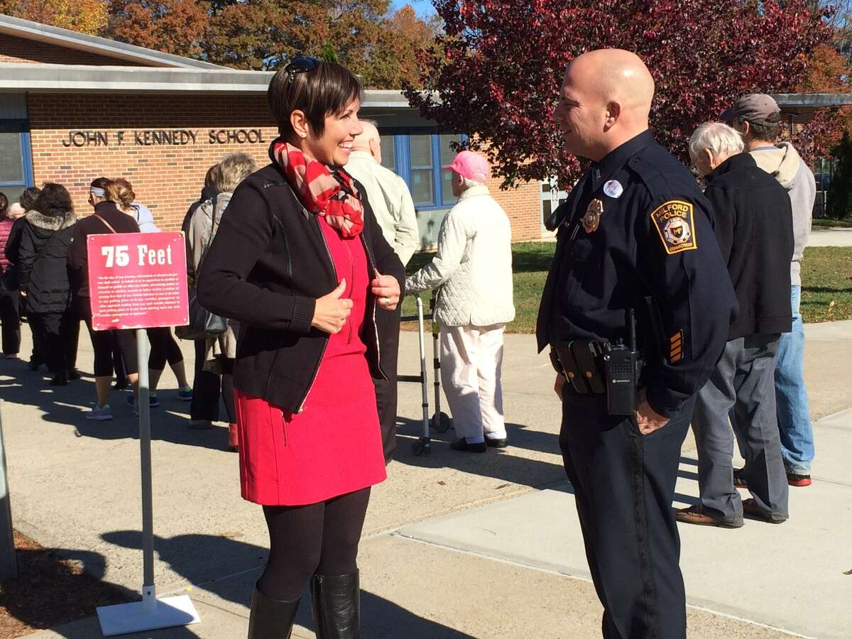 Pam Staneski, incumbent candidate for state representative (R-119), greets voters outside John F. Kennedy School in Milford.