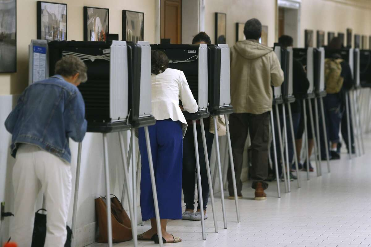 Voters mark their ballots on Election Day at City Hall in San Francisco, Nov. 8, 2016.