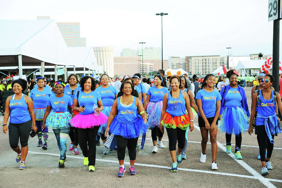 A Cypress area GirlTrek leader, Shelia Woodard, center, is walking with others and encouraging other black women to join the movement of self-care and promoting wellness amongst others. Photo: Tony Gaines, Photo