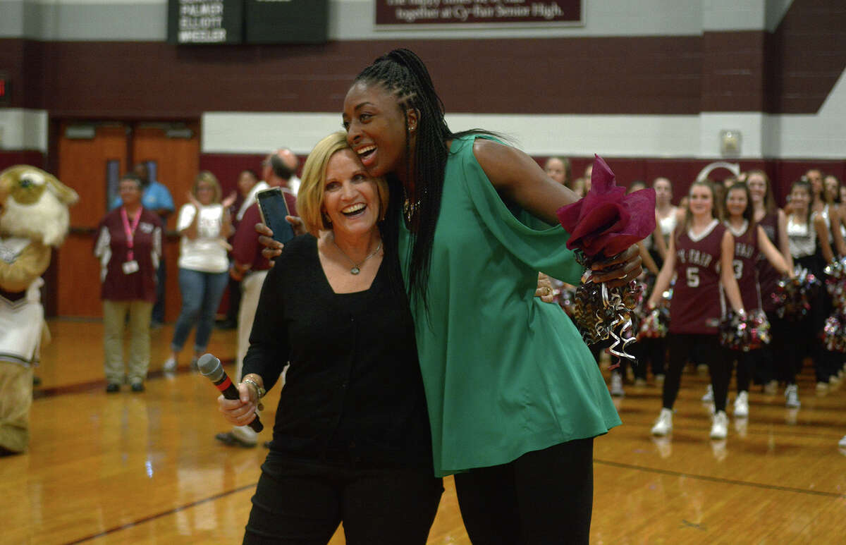 Nneka Ogwumike, right, shares a hug with her former coach, Cy-Fair High School Head Girls Basketball Coach Ann Roubique, during the pep rally held to honor Ogwumike in the school gym on Friday, Oct. 28, 2016. (Photo by Jerry Baker/Freelance)