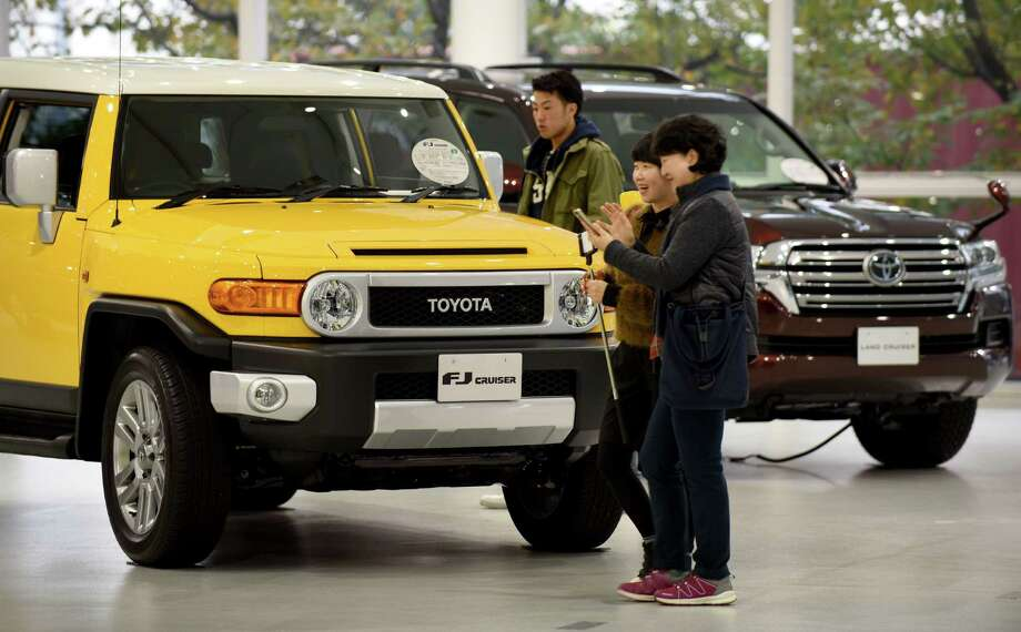 A stronger yen and lagging sales weighed on Toyota's bottom line in its fiscal second quarter. It reported that profit fell 36 percent to $3.8 billion. Photo: Toru Yamanaka /AFP /Getty Images / AFP or licensors