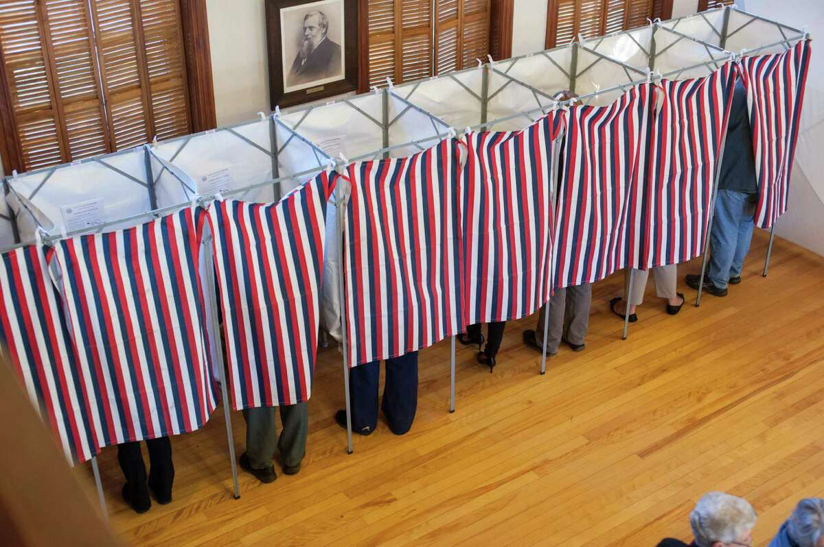 Voters cast their ballots at the Sutton town hall in the US presidential election November 8, 2016 in Sutton, New Hampshire.