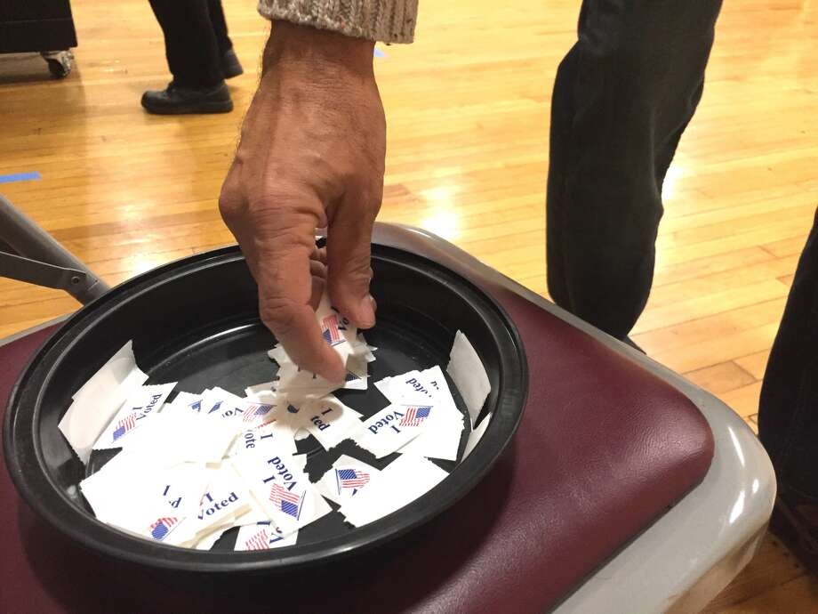 A voter picks up an 'I Voted' sticker as he leaves the polling location in the Bethel municipal center on Tuesday, Nov. 8, 2016. Photo: H John Voorhees III, Danbury News-Times