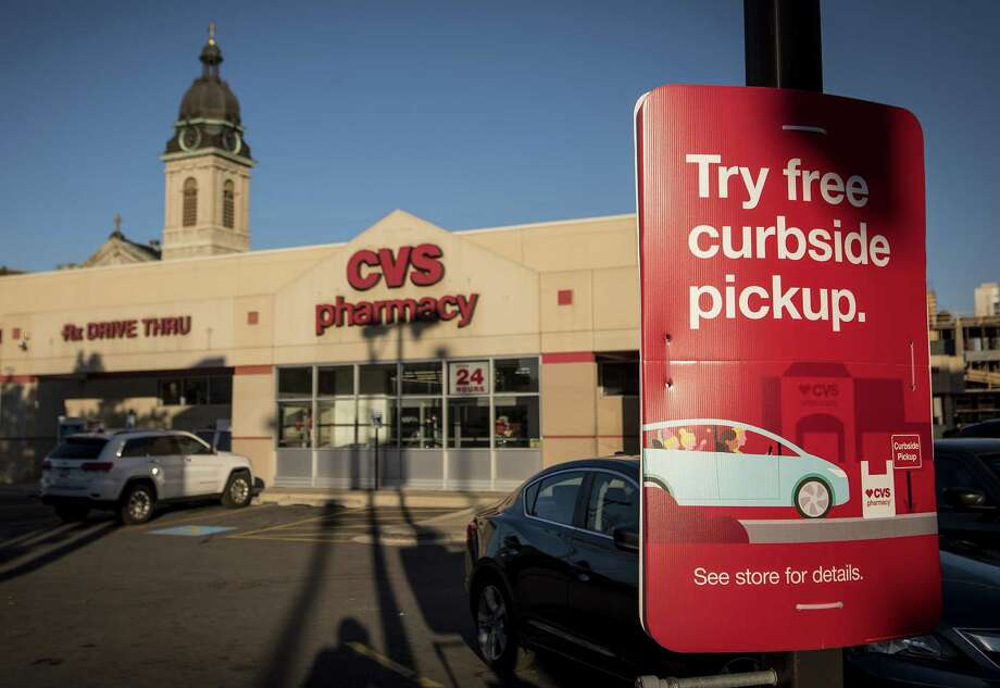 A sign for curbside pickup is displayed outside of a CVS Health Corp. store in Chicago, Illinois, U.S., on Sunday, Nov. 6, 2016. CVS Health Corp. is scheduled to release earnings figured on November 8. Photographer: Christopher Dilts/Bloomberg Photo: Christopher Dilts /Bloomberg News / © 2016 Bloomberg Finance LP