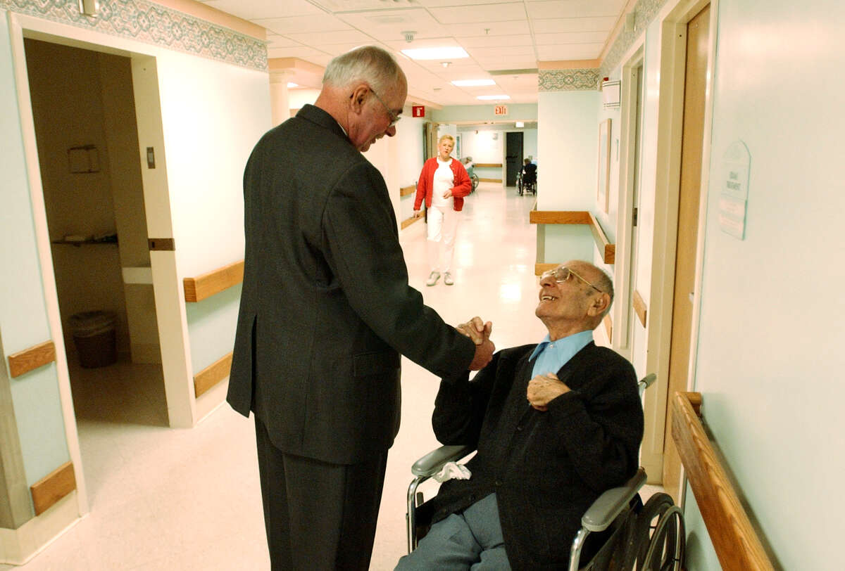 Rensselaer County Social Services Director John Beaudoin, left, speaks with John Barsamian at Van Rensselaer Manor in this 2003 archive photo. (Times Union archive)