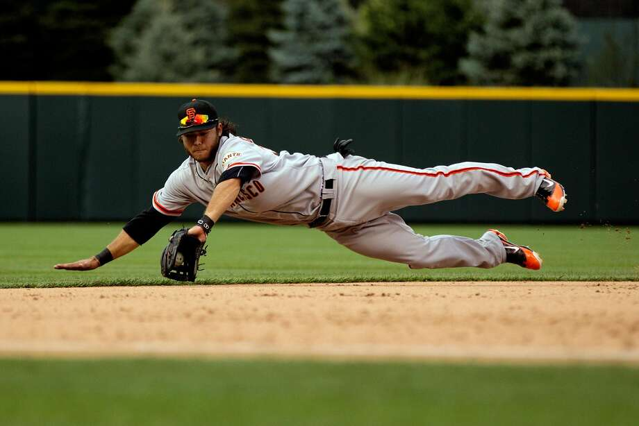 Brandon Crawford's diving stops have become the routine. Photo: Justin Edmonds, Getty Images