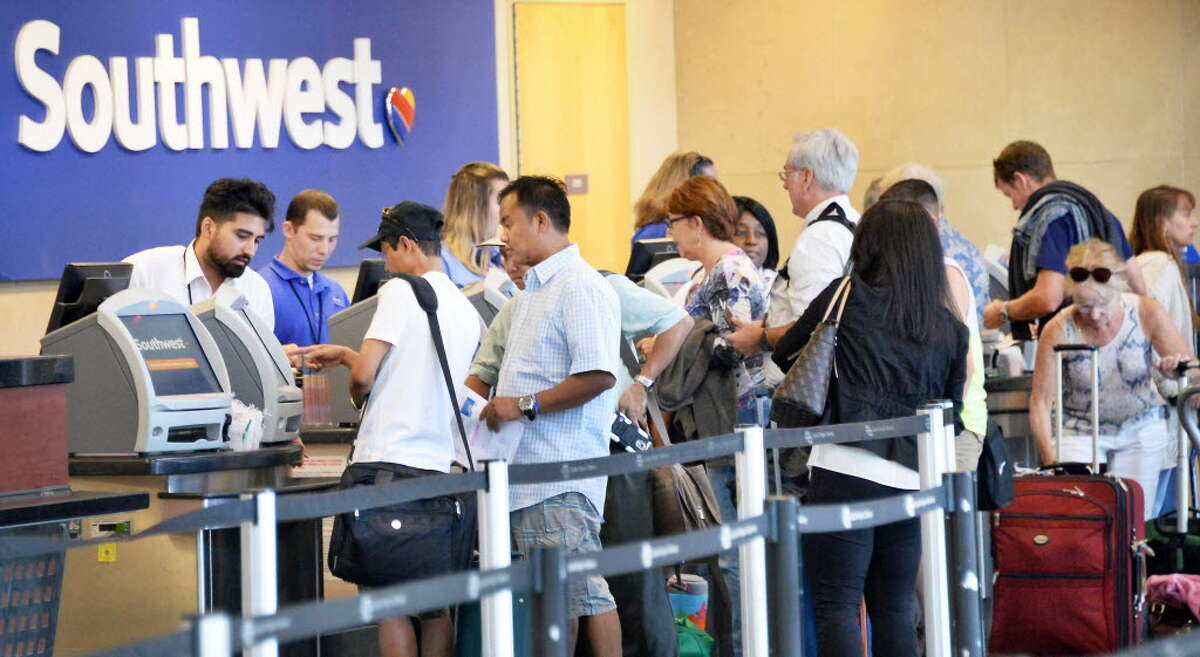 Passengers at the Southwest ticket counter at Albany International Airport. The airline plans to offer daily nonstops year-round between Albany and Denver beginning next April.